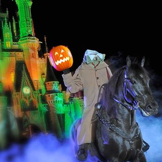 The Headless Horseman leads the Halloween Parade.