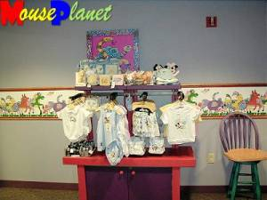 Infant clothing and other items for sale.