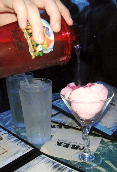 Caroline's Cotton-tini drink being made (vodka and cotton candy)!