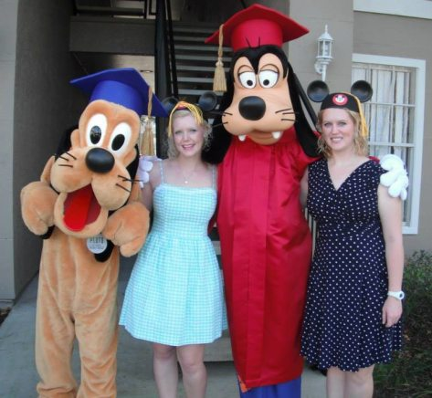 Graduation day for us! (Pluto was playing with the tassel on Caroline's head.)