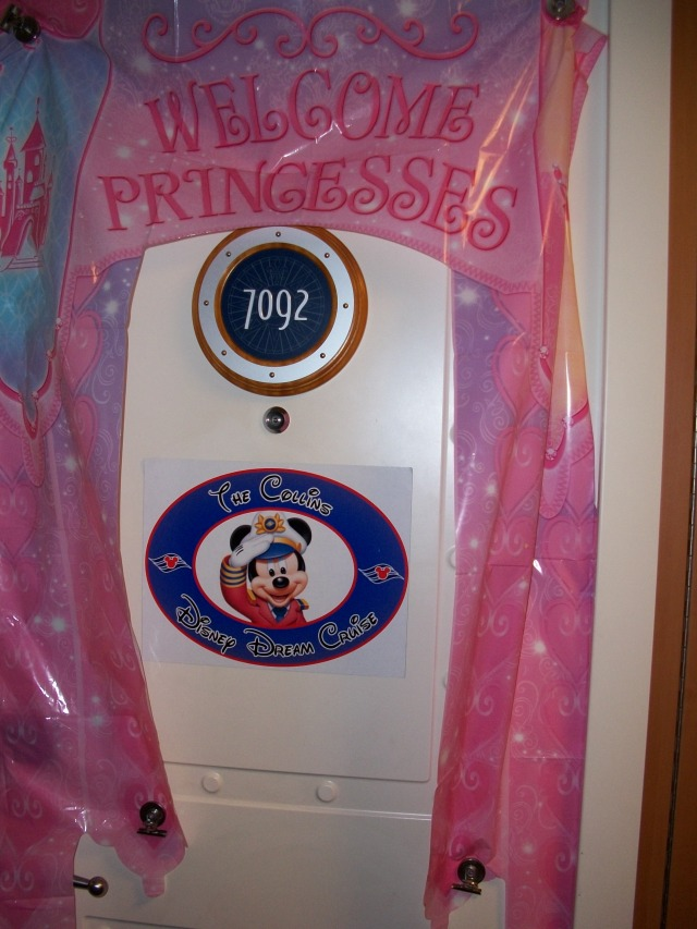 Our decorated cabin door.  The doors are made of metal and you can use magnets to decorate it.  We got our name decal off of ebay before the cruise, and the ship's gift shops also sell door décor.
