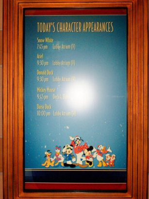 LED screen listing character appearances throughout the day, 8am-10pm.