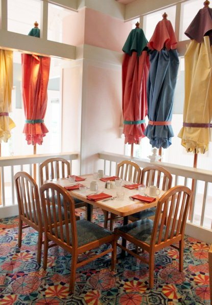 The carpet matches the umbrella decor.
