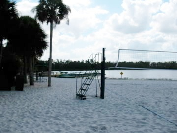 Beach volleyball on white sand beach.