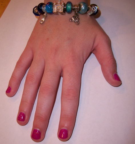 Caroline's Fushia mani with a silver sparlke top coat. Pretty!