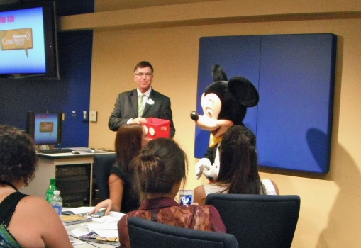 August 2013: Mickey handing out our name tags!  ;')