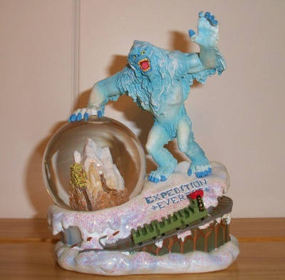 Yeti on the mountain snow globe.