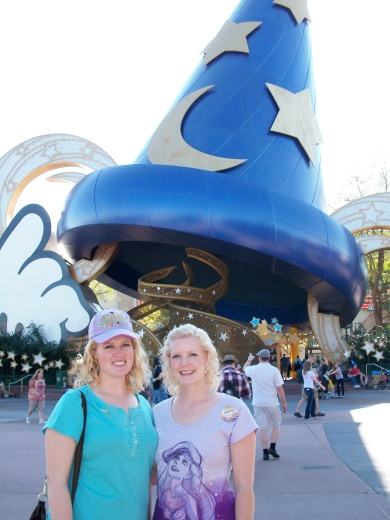 Standing at Mickey's Magician Hat in Hollywood Studios