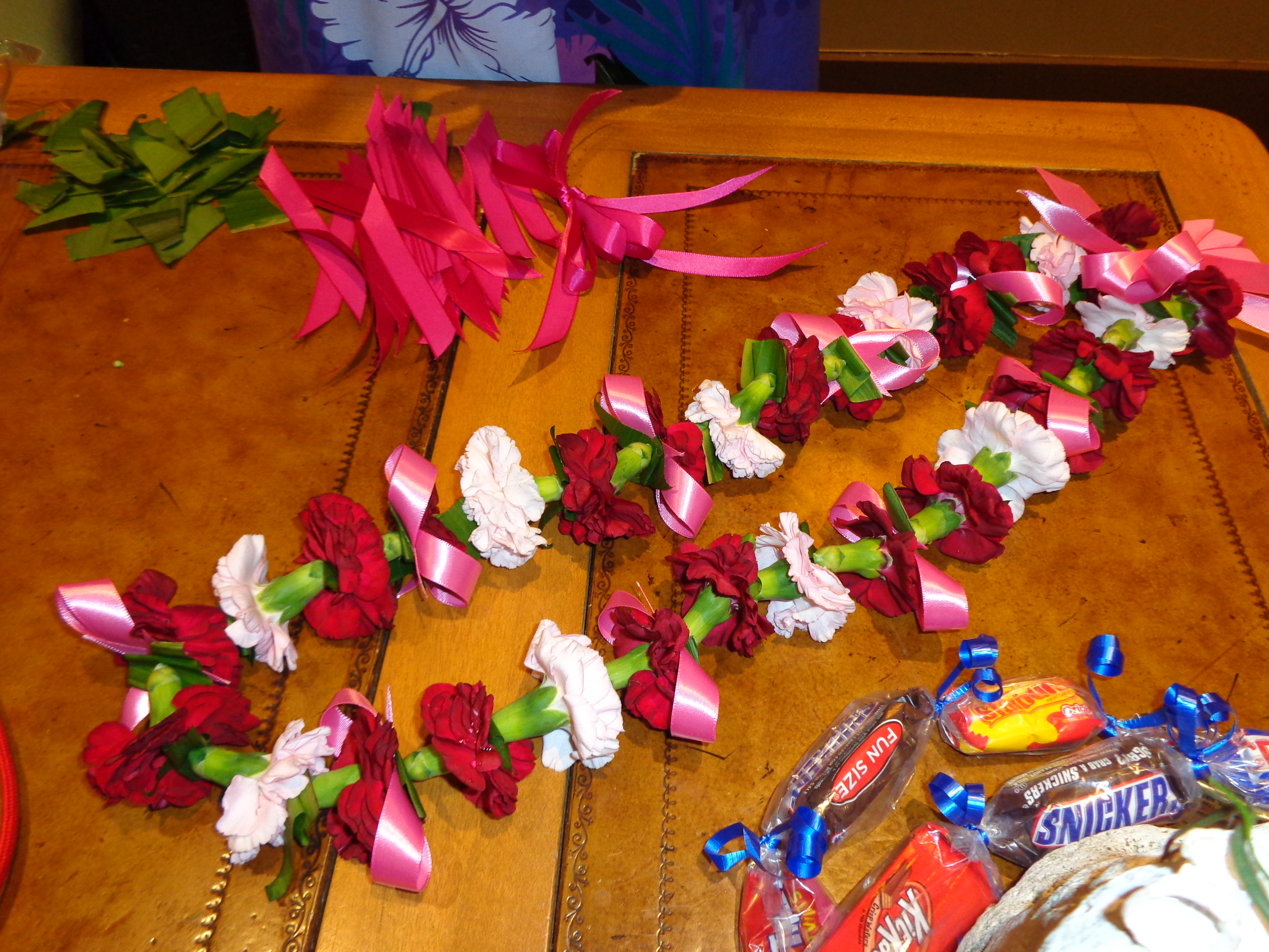 Polynesian resort elly and carolines magical moments this is a carnation lei with rose colored ribbons next to it is a candy lei for kids buycottarizona Gallery