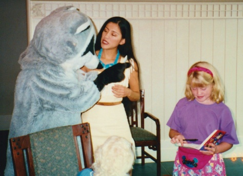 Meeko signing Elly's autograph book.  Nov. 1996.