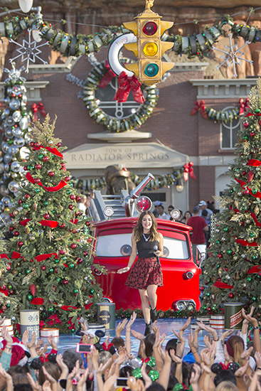 "Over in Disney California Adventure park, Lucy Hale brought holiday cheer to Cars Land with her performance of ""Mistletoe."""