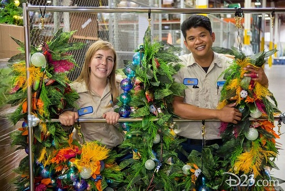 Ali Irvine and Mark Apepe pose with the colorful and under-the-sea-themed garland they created for The Little Mermaid ~ Ariel's Undersea Adventure at Disney California Adventure.