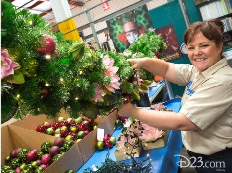Mary Ellen Riva lights up a garland in the Resort Enhancement Warehouse.