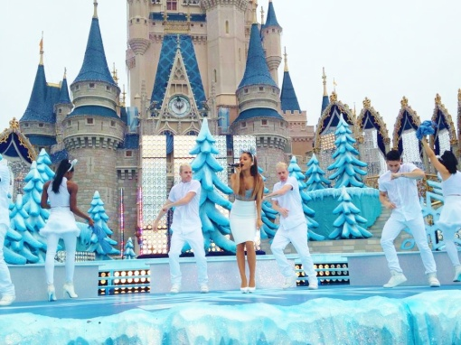 "Adriana Grande singing two songs, ""Santa Tell Me"" and ""Last Christmas"" in front of the Castle."