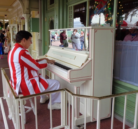 Famous Jim playing ragtime tunes on the piano.