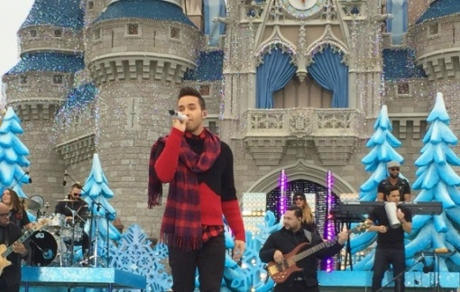 "Prince Royce singing ""Feliz Navidad""."