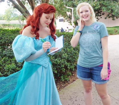 Ariel signing Caroline's autograph book.