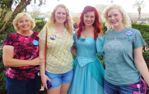 Meeting the 'land' Ariel for the first time.  Beautiful dress!