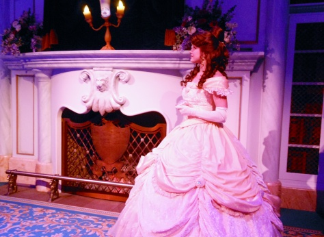 Belle talking with Lumiere on the fireplace mantel.