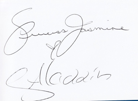 They both signed Caroline's autograph book.