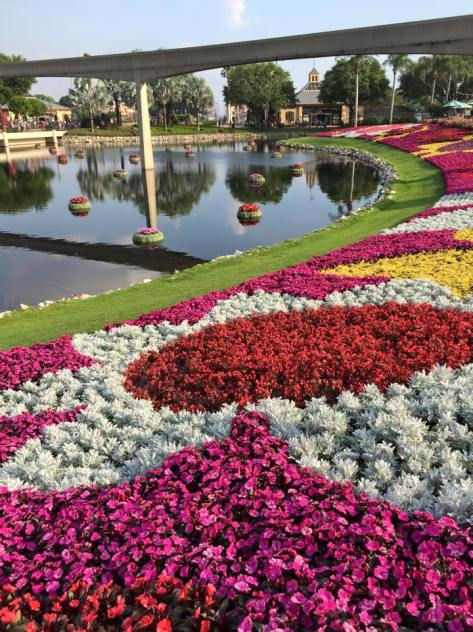 Flowers surrounding Friendship Bay at Epcot