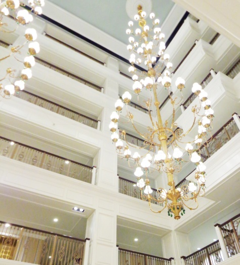 45-foot brass and green crystal chandeliers in the grand lobby.