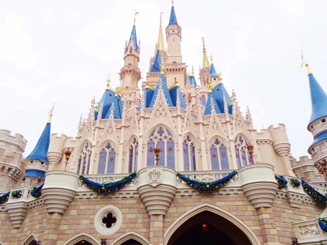 Cinderella Castle decorated with sparkling blue bunting for the holidays.