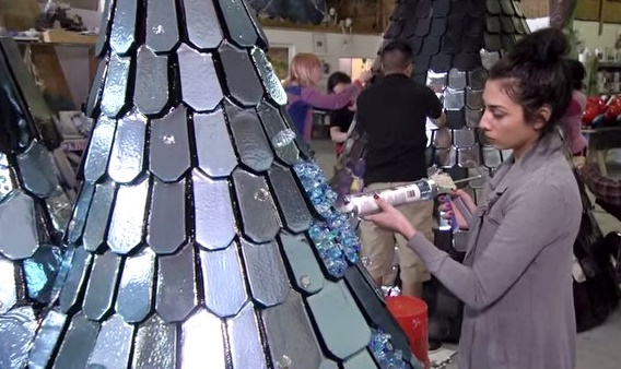 Hand glueing on thousands of jewels to the mirrored surfaces.
