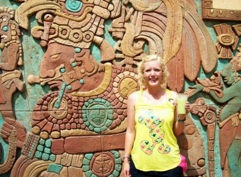 Caroline outside Epcot Mexico pavilion with a cool drink, but NOT climbing the Mayan Temple steps!