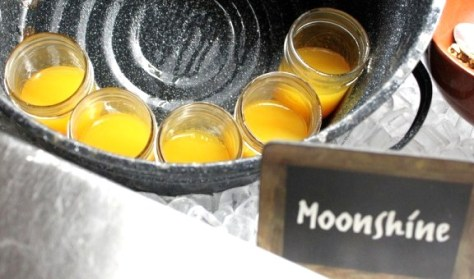 Moonshine juice in glass canning jars.