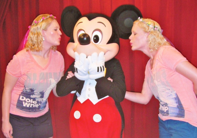 Mickey kissing two girls